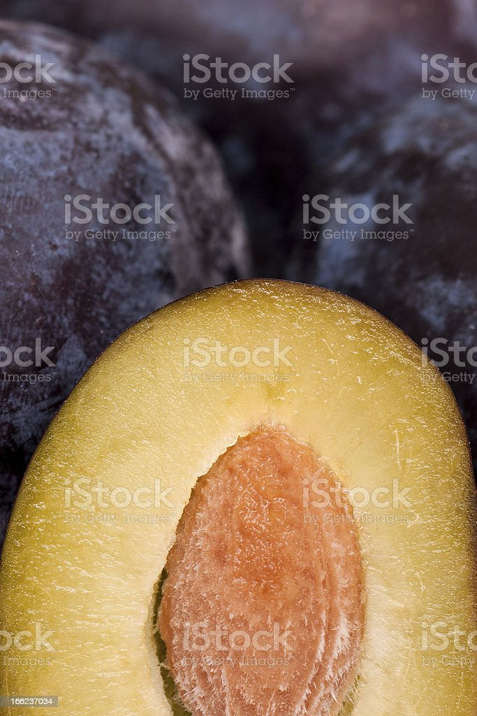 Sliced plum with pit royalty-free stock photo