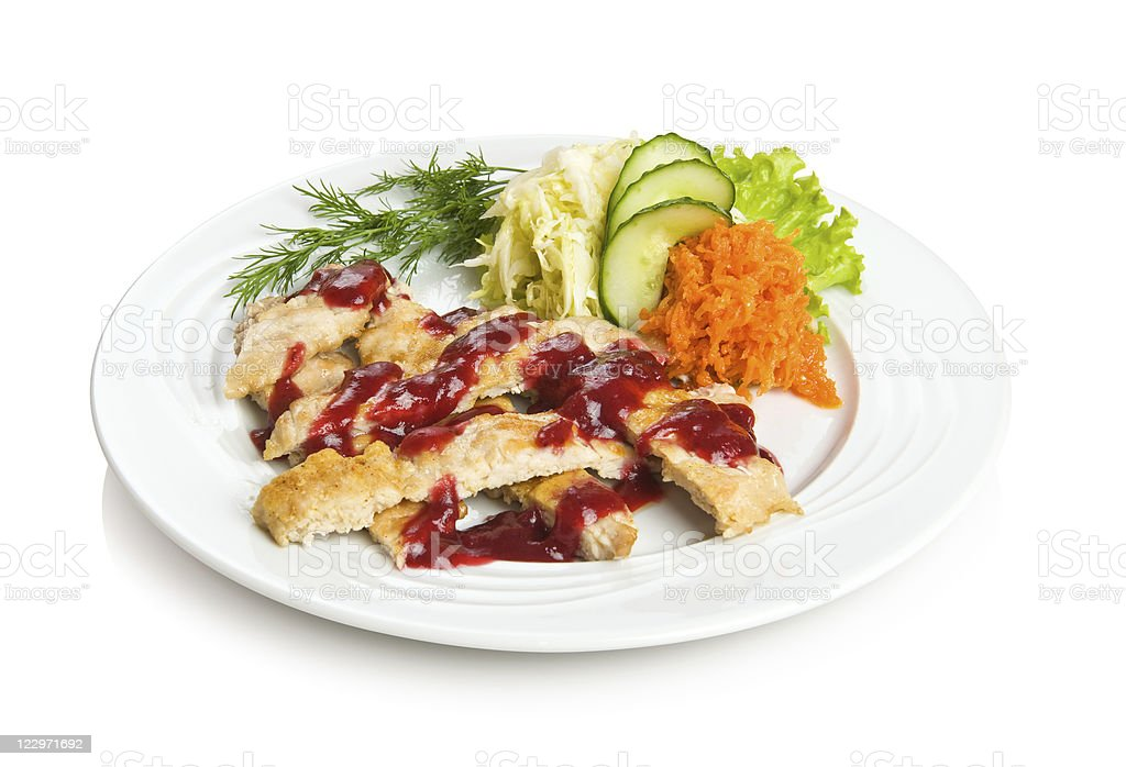 Sliced pork chop with cowberry sauce royalty-free stock photo
