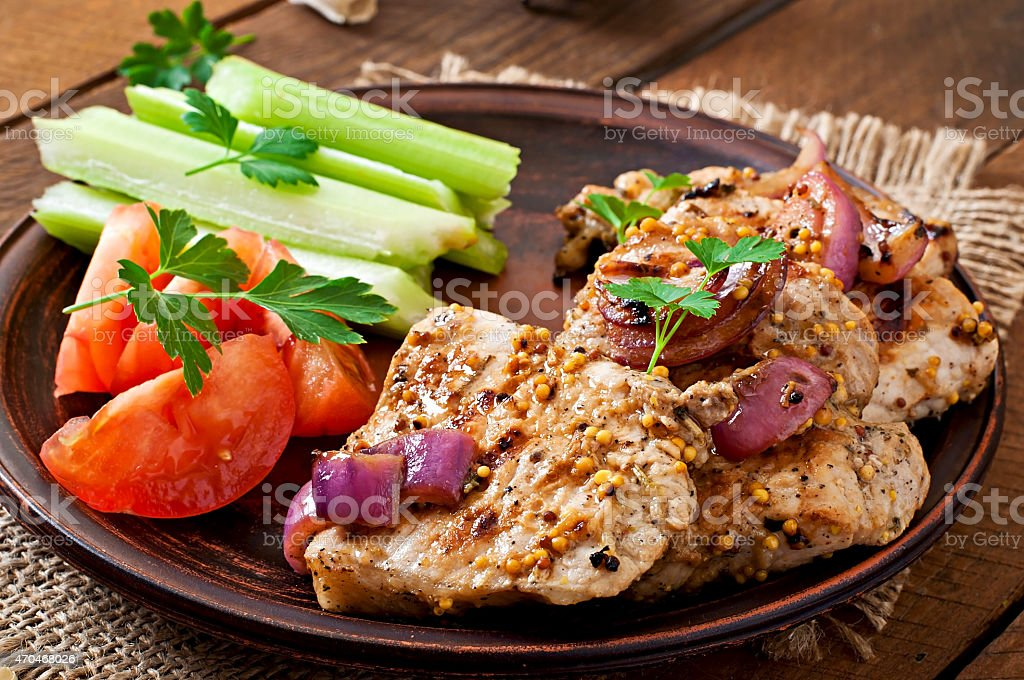 Sliced pork grilled with vegetables on  bowl. stock photo