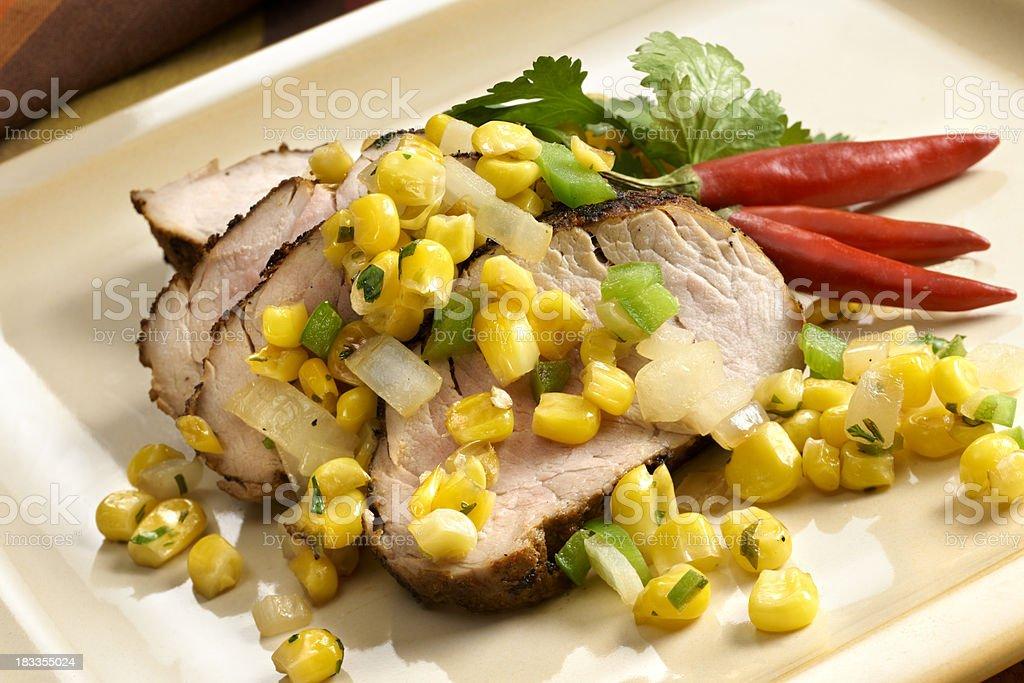 Sliced Pork Tenderloin with Spicy Corn Relish royalty-free stock photo