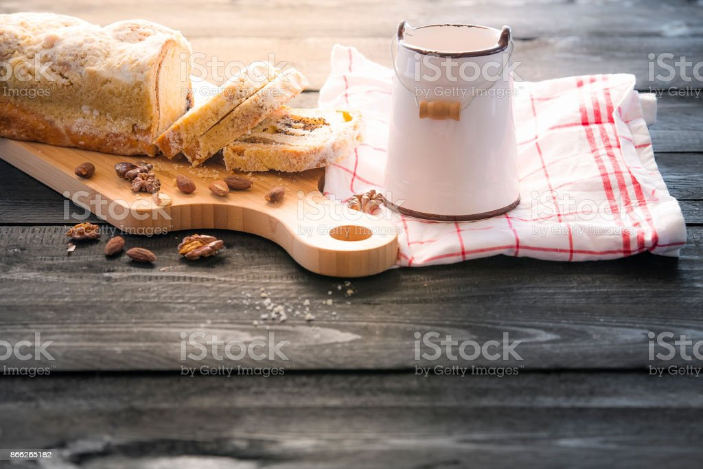 Sliced pound cake on wooden table stock photo