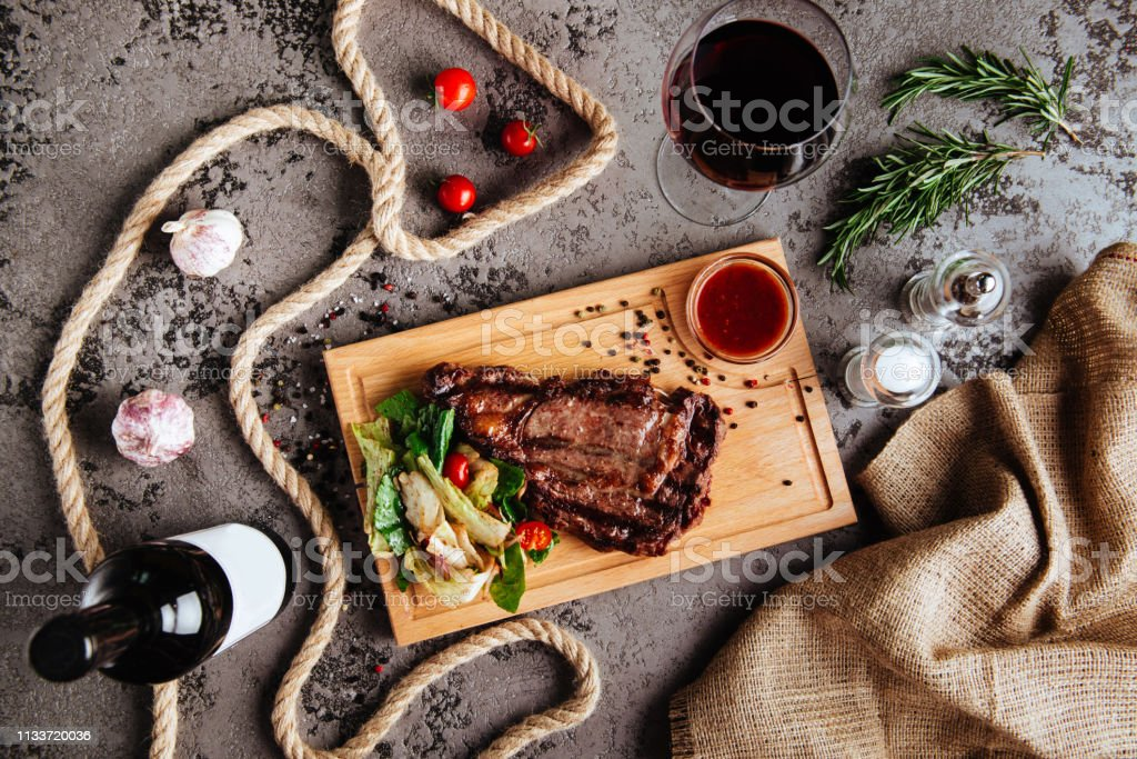 Sliced Prime Ribeye Steak On Black Stone Plate Stock Photo Download Image Now Istock