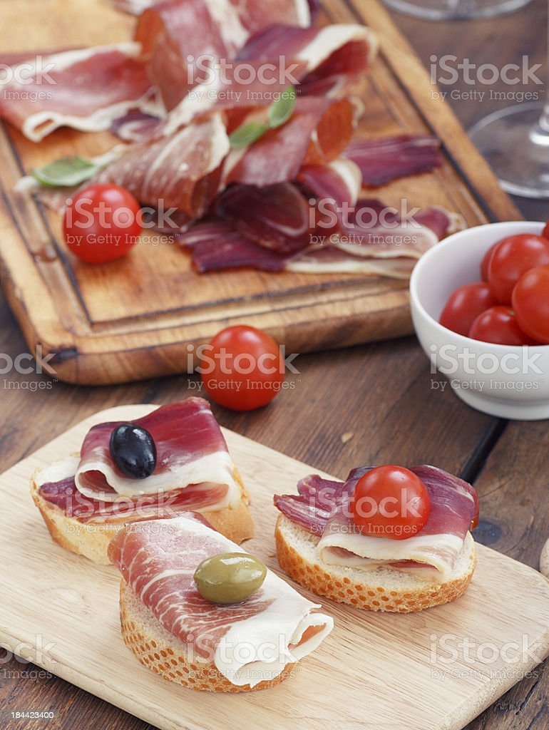 sliced prosciutto with olive cheese and Cherry tomato royalty-free stock photo