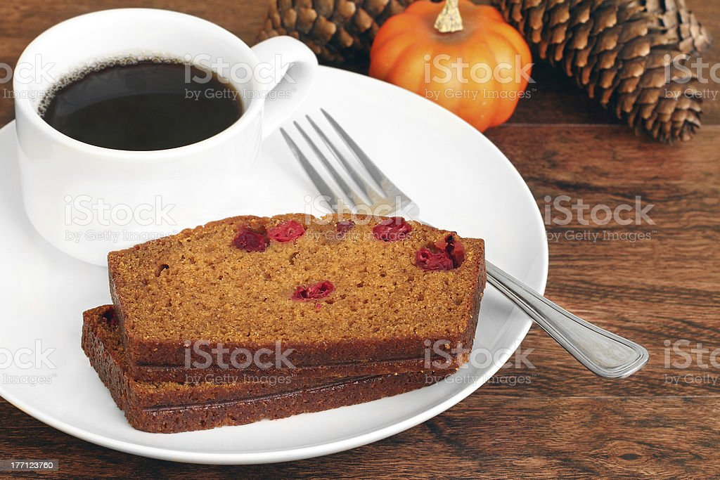 Sliced Pumpkin Cranberry Cake with Coffee stock photo