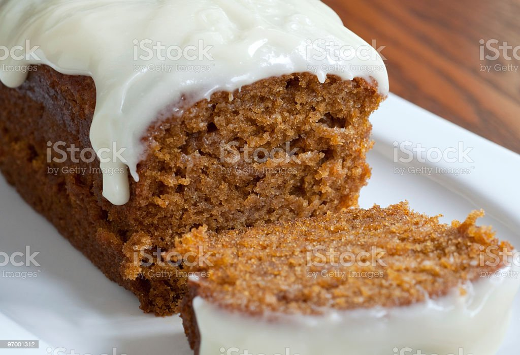 Sliced Pumpkin Loaf with Cream Cheese Icing stock photo