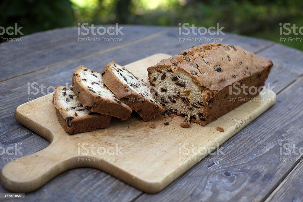 Sliced raisin bread on cutting board old table stock photo