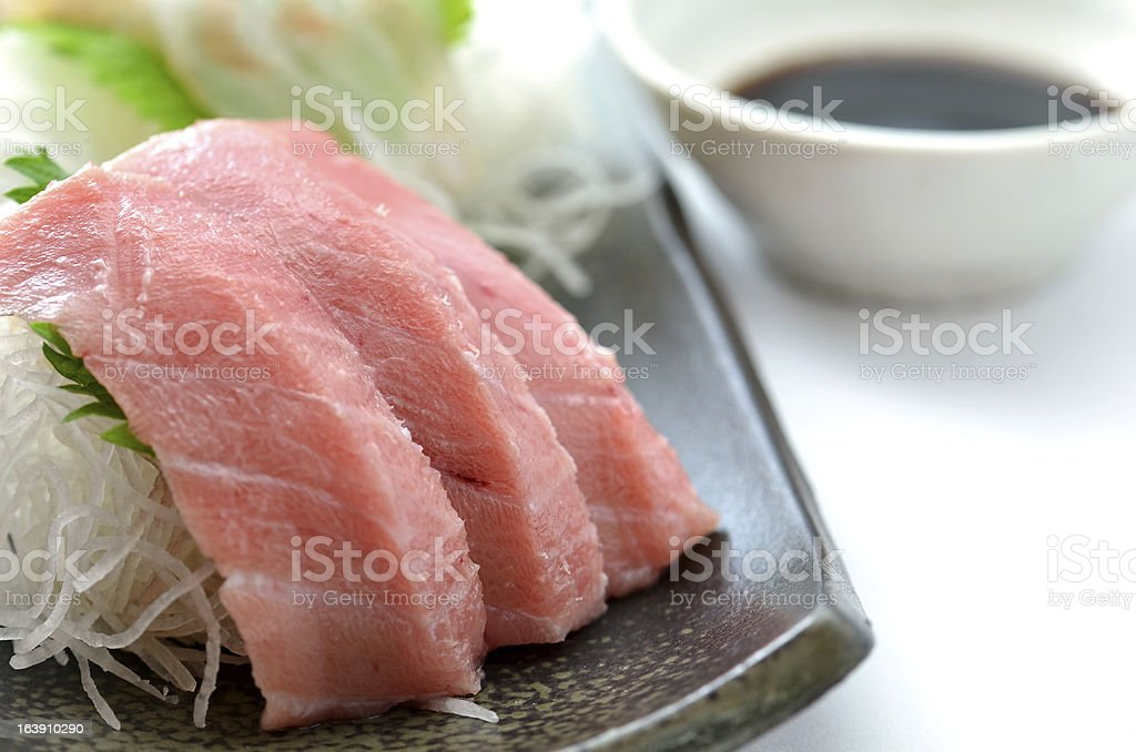 Sliced raw fish called Sashimi royalty-free stock photo