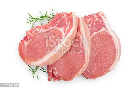 sliced raw pork meat with rosemary isolated on white background. Top view. Flat lay.