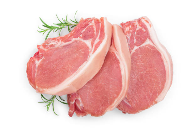 sliced raw pork meat with rosemary isolated on white background. Top view. Flat lay sliced raw pork meat with rosemary isolated on white background. Top view. Flat lay. pork stock pictures, royalty-free photos & images