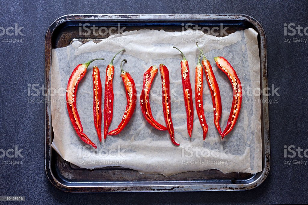 Sliced red chillies on a baking sheet stock photo
