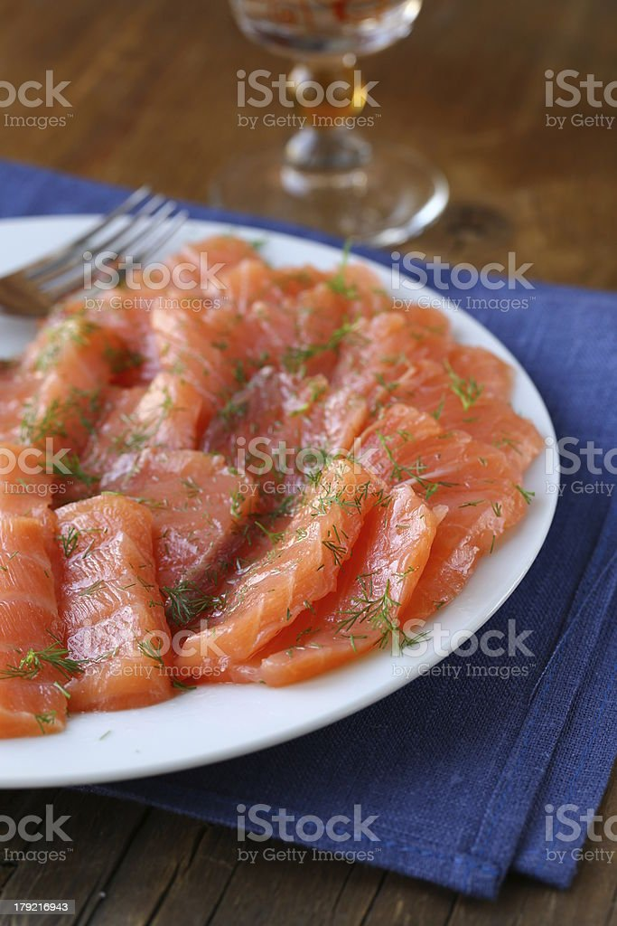 sliced red fish (Salmon) with dill - gourmet appetizer royalty-free stock photo