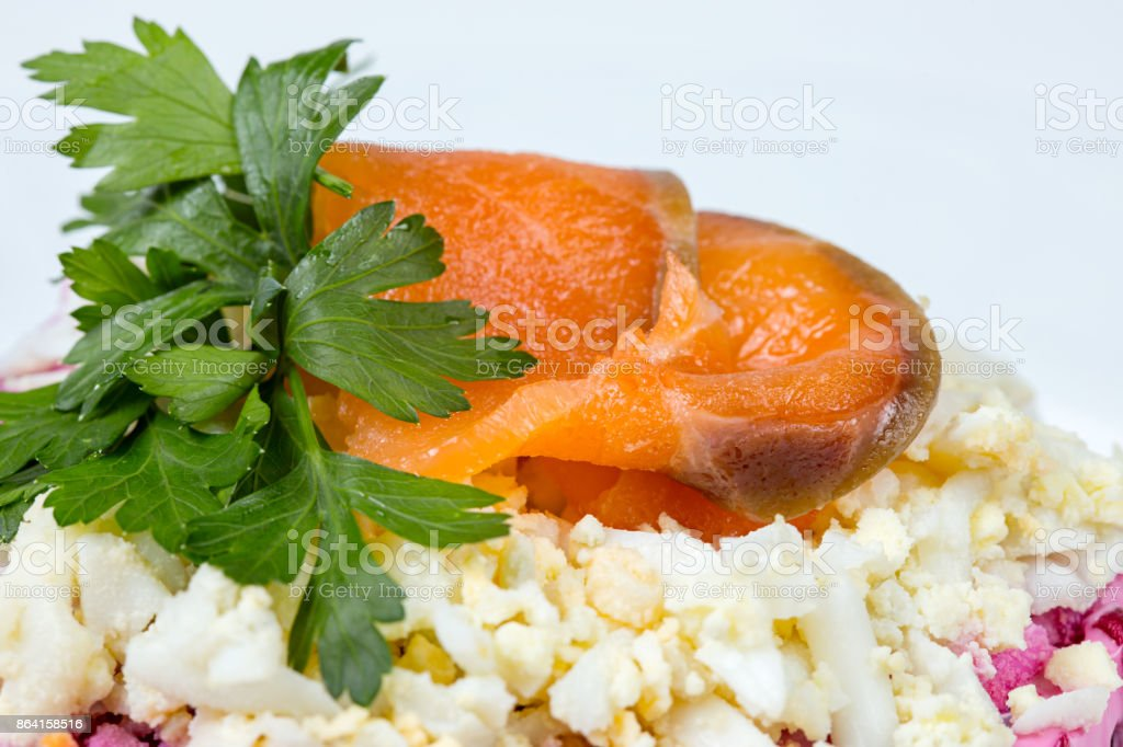 Sliced red fish with green parsley royalty-free stock photo