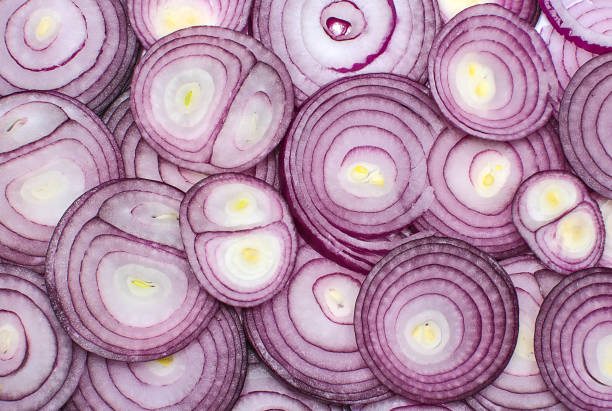 Sliced red onion rings Background of sliced red onion rings. Concept of common culinary vegetables. Spicy food. spanish onion stock pictures, royalty-free photos & images