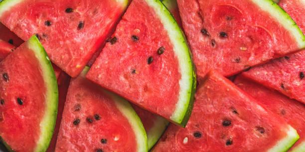 Fatias de melancia vermelha. Textura e fundo de frutas - foto de acervo
