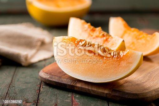 Sliced ripe melon on a cutting board