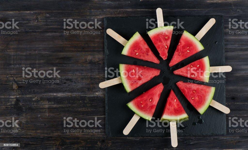 Sliced ripe watermelon, above view. stock photo