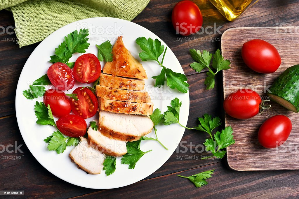 Sliced roasted chicken breast stock photo