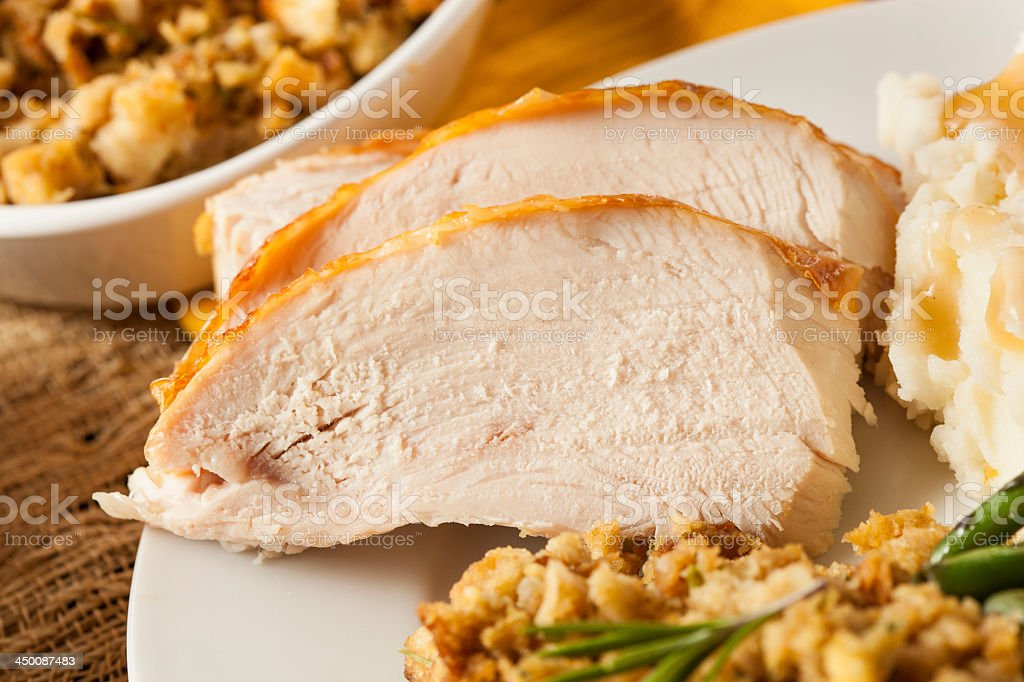 Sliced roasted turkey breast with herbs and salad stock photo