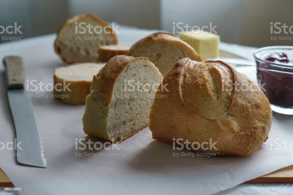 Sliced Rustic Bread, Butter, and Jelly (Side View) stock photo