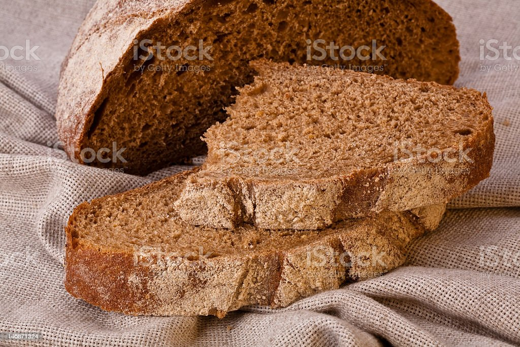 Sliced rustic brown bread stock photo
