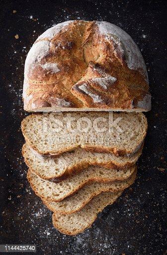 Sliced rye bread on a dark cooking pan