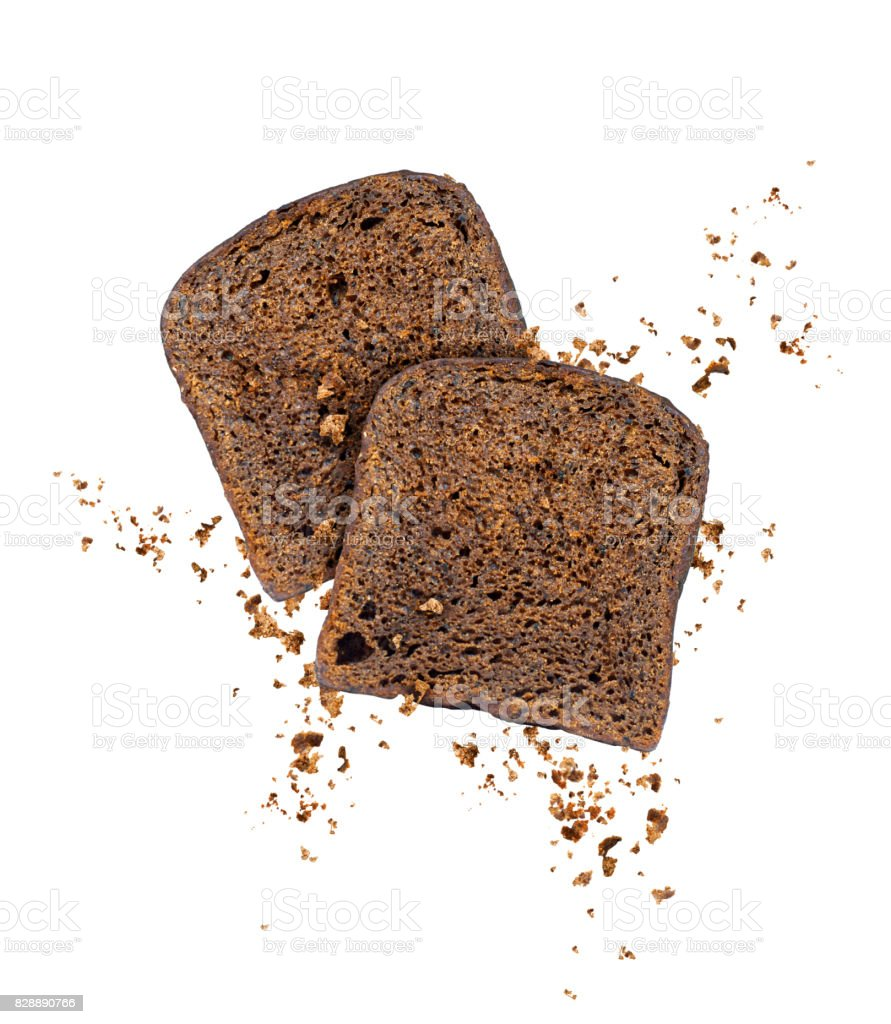 Sliced rye bread with crumbs frozen in the air on a white background stock photo
