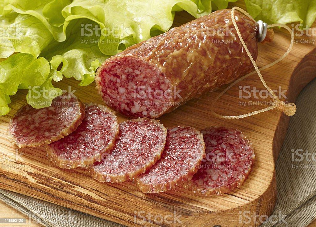 sliced salami on cutting board royalty-free stock photo