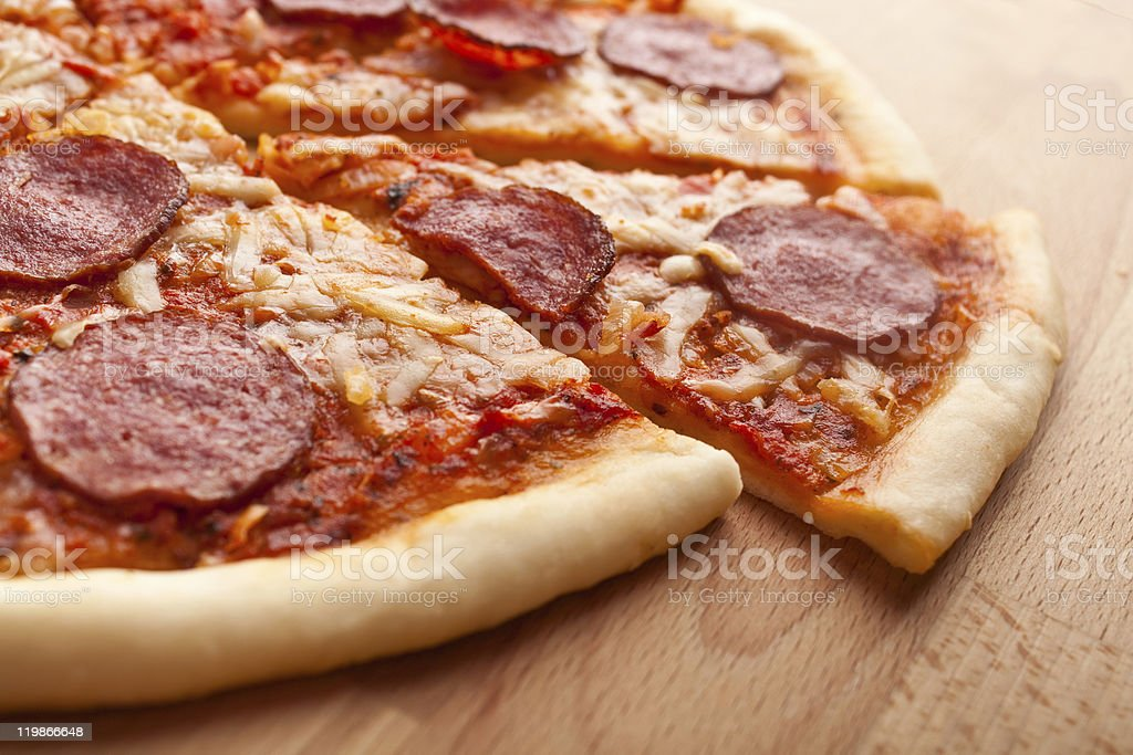 sliced  salami pizza stock photo