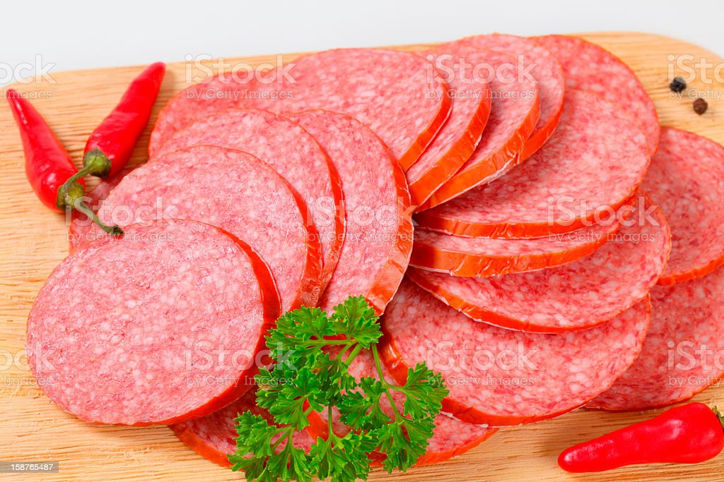 sliced salami with spices royalty-free stock photo