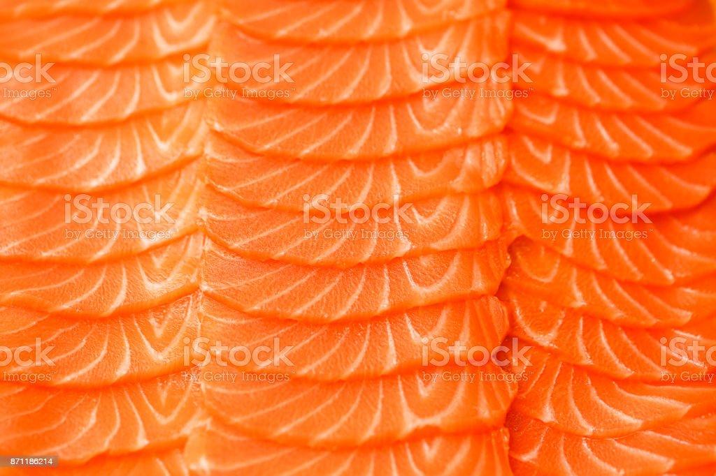 Filete de salmón en rodajas. Foto de la textura del primer plano. Fotografía macro. Antecedentes del concepto de alimentos - Foto de stock de Abstracto libre de derechos