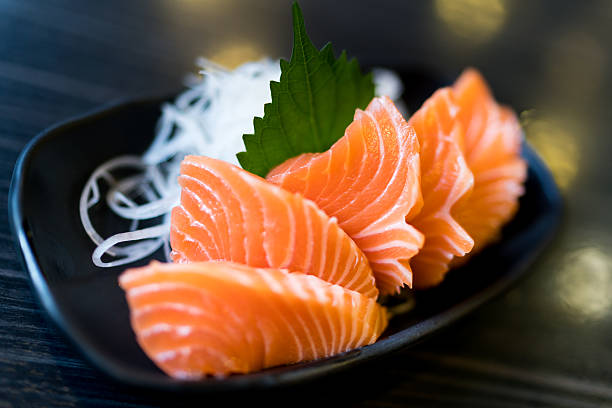 Sliced salmon sashimi, Japanese raw food delicious menu Sliced salmon sashimi, Japanese raw food delicious menu, famous fish from Norway salmonidae stock pictures, royalty-free photos & images