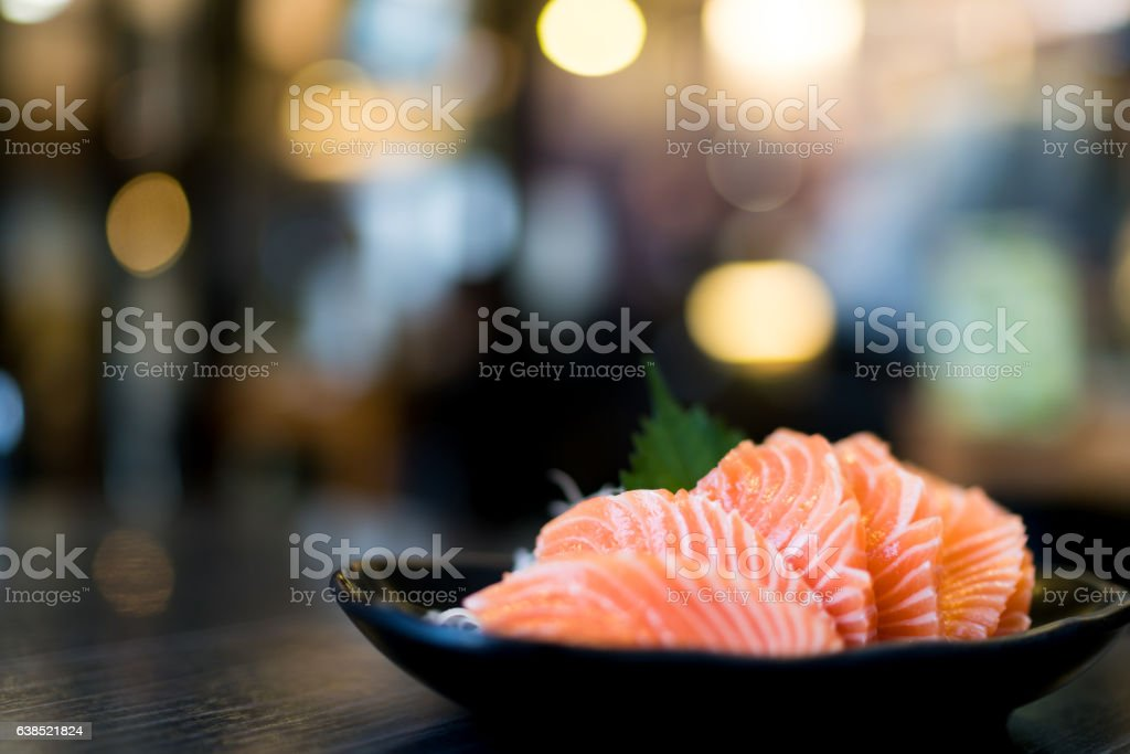 Sliced salmon sashimi served on wooden table – Foto