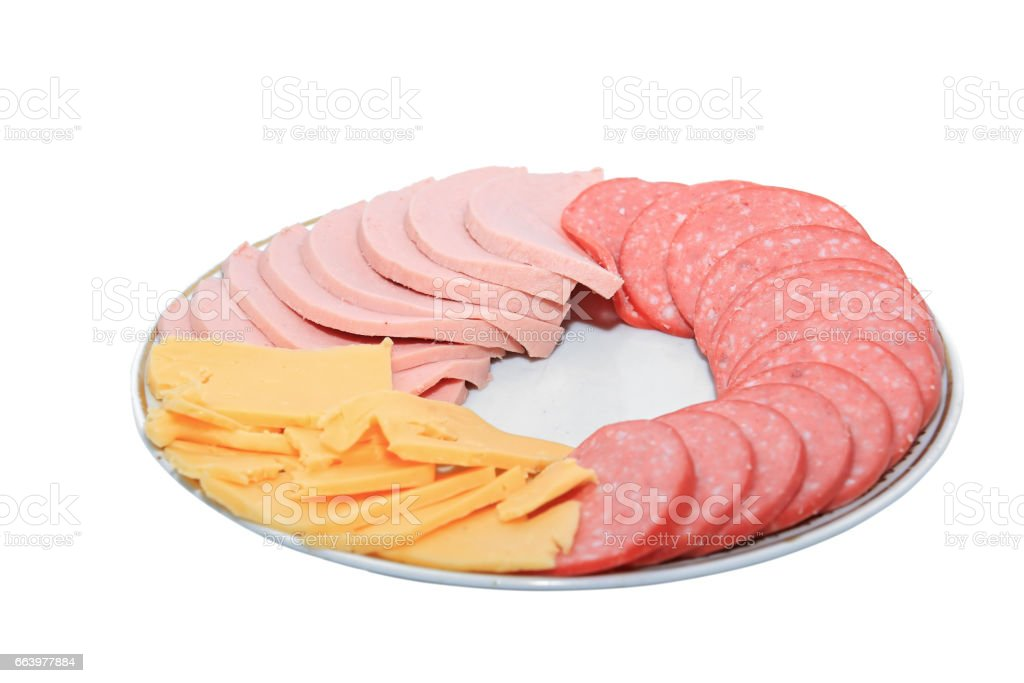 Sliced sausage and cheese on a plate on a white background stock photo