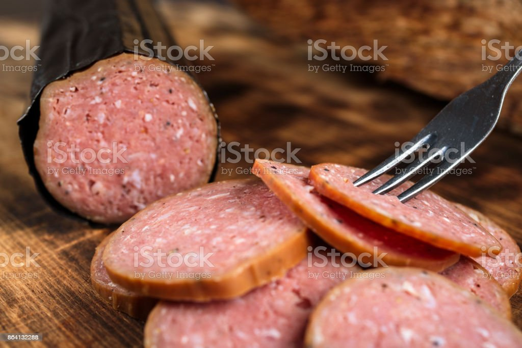 Sliced sausage with fork royalty-free stock photo