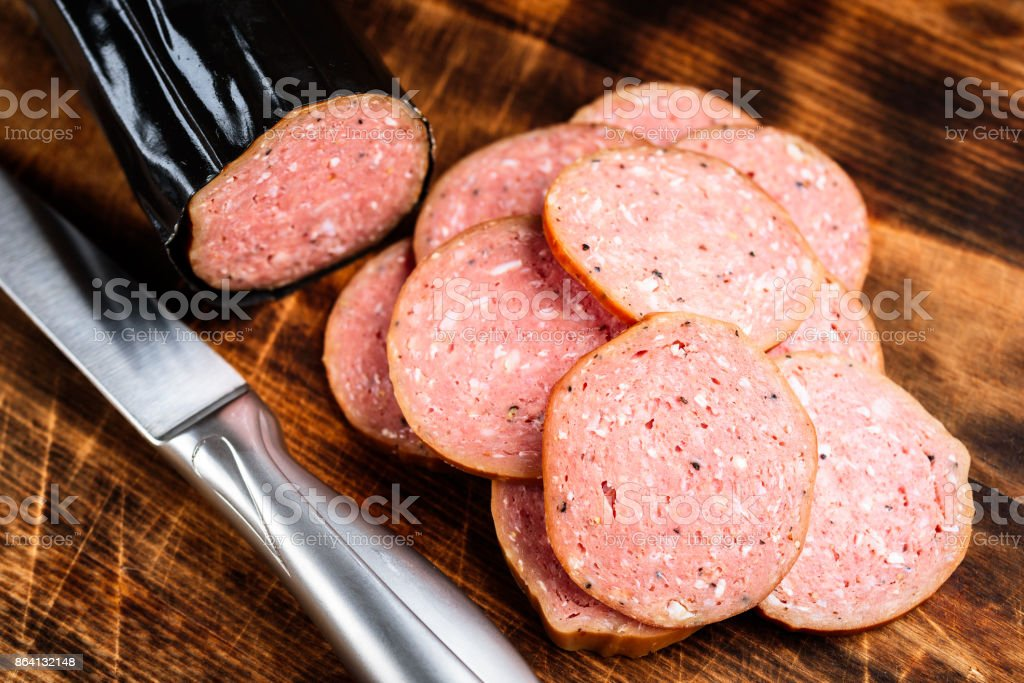 Sliced sausage with knife royalty-free stock photo