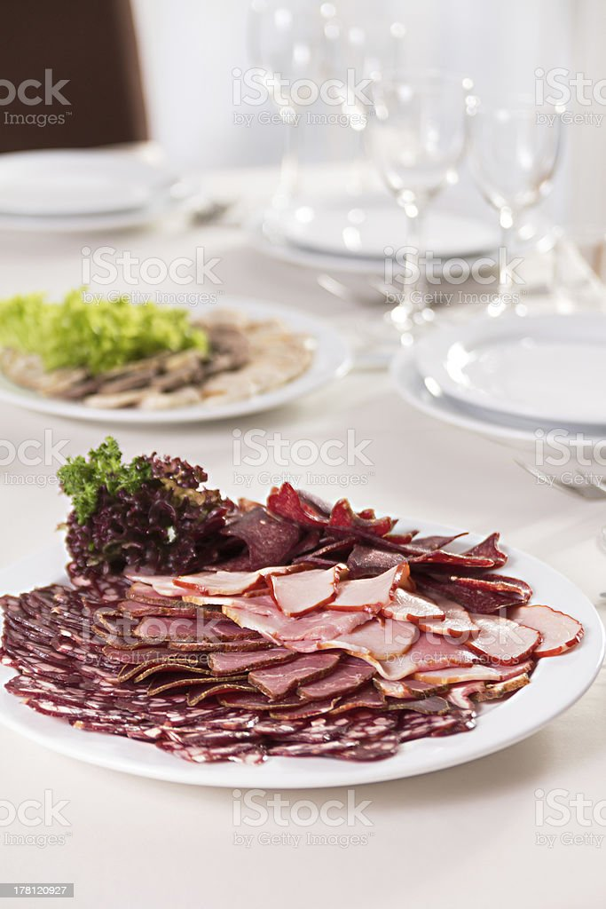 sliced sausages and ham on a plate royalty-free stock photo