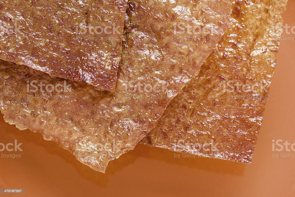 Sliced sheets of dried and crispy pork. stock photo