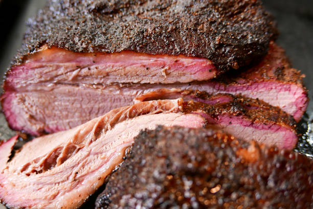 Sliced smoked brisket, close-up. stock photo