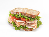 Sliced Smoked Turkey Sandwich with Lettuce and Tomatoes - Photographed on a Hasselblad H3D11-39 megapixel Camera System