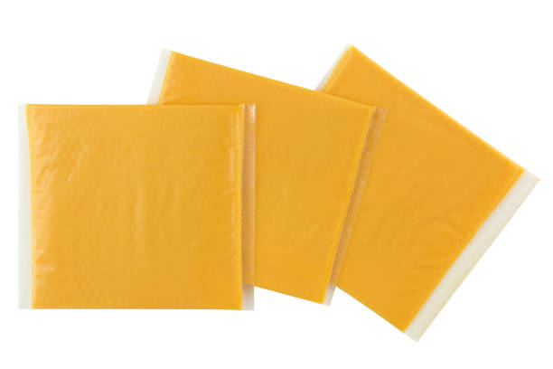 Sliced Smokey BBQ processed cheese, single slice wrapped in package isolated on white stock photo
