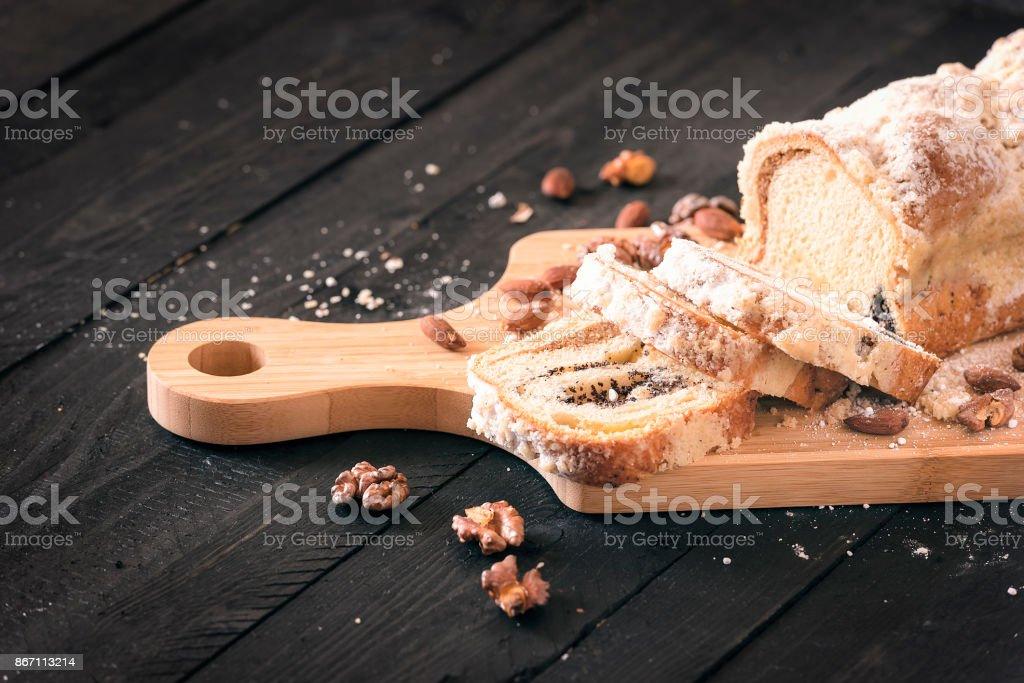 Sliced sponge cake on wooden trencher stock photo