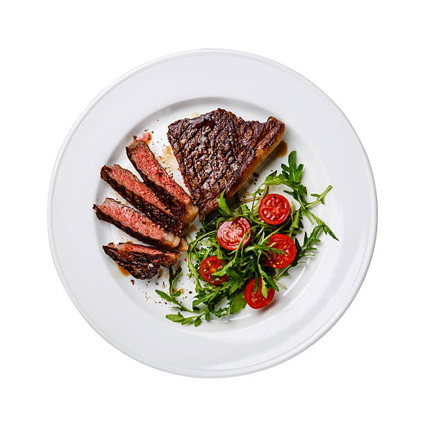 Sliced steak and salad isolated