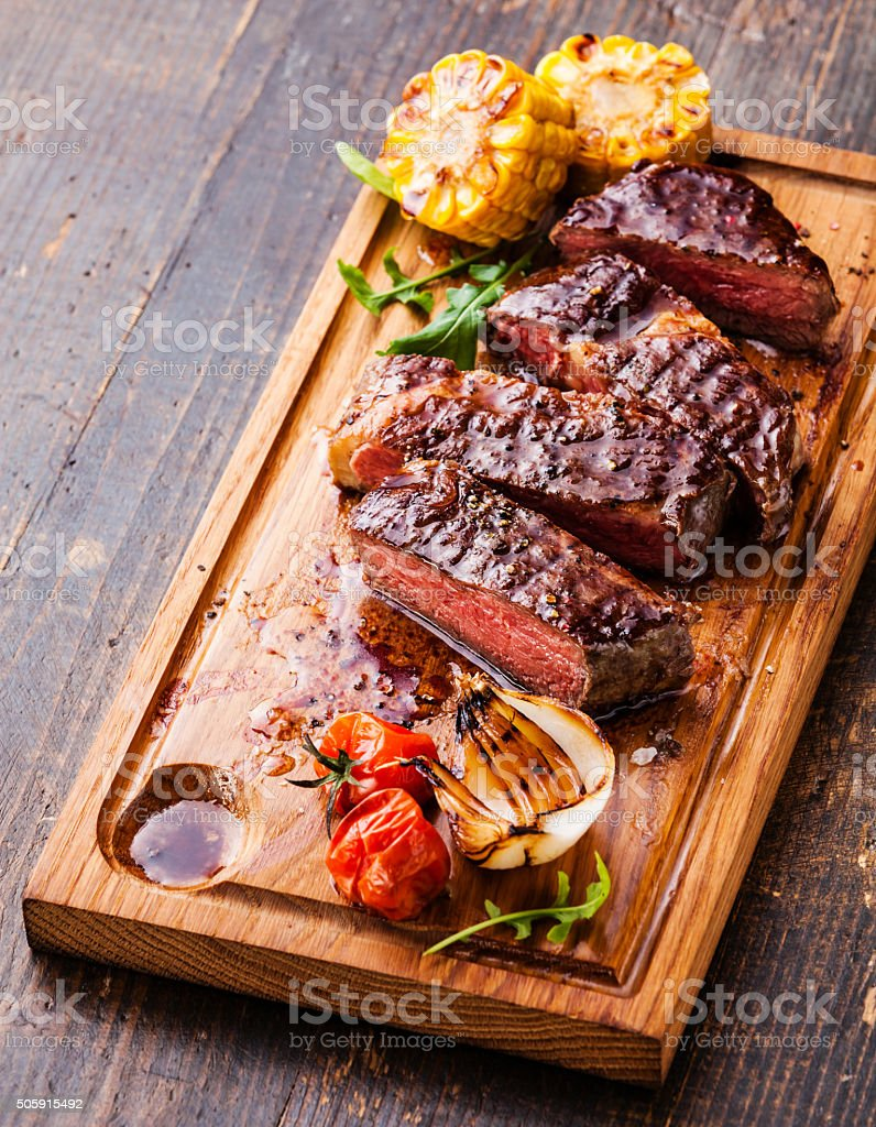Sliced steak Ribeye with corn and tomatoes stock photo