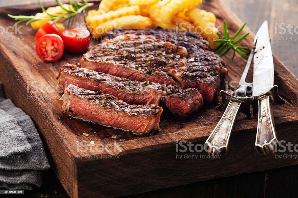 Sliced Steak Ribeye with french fries stock photo