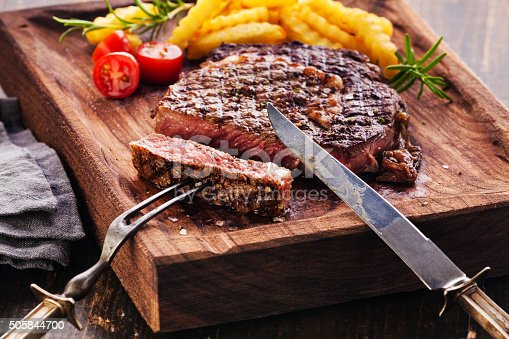 istock Sliced Steak Ribeye with french fries 505844700
