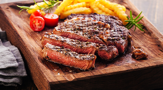 istock Sliced Steak Ribeye with french fries 505844732