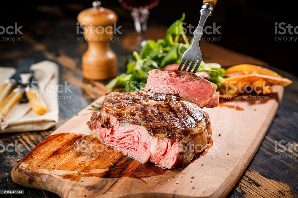 Sliced steak Ribeye with spice and French fries stock photo