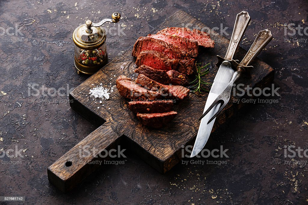 Sliced steak roastbeef with knife and fork stock photo