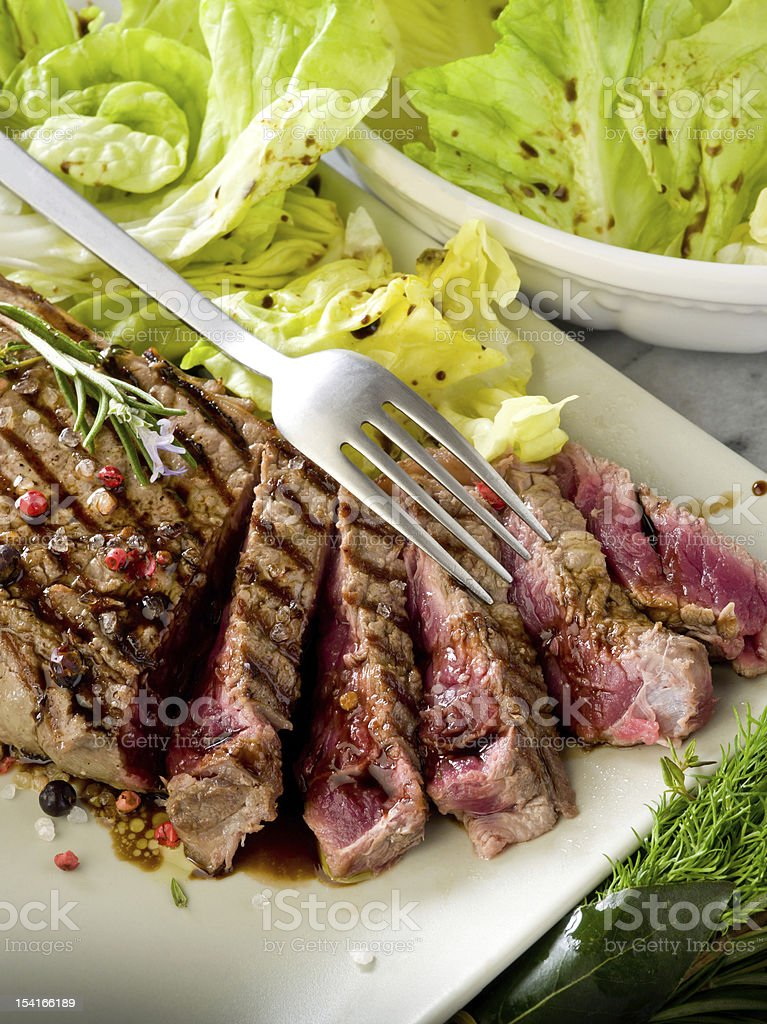 sliced steak with balsamic vinegar and green salad royalty-free stock photo