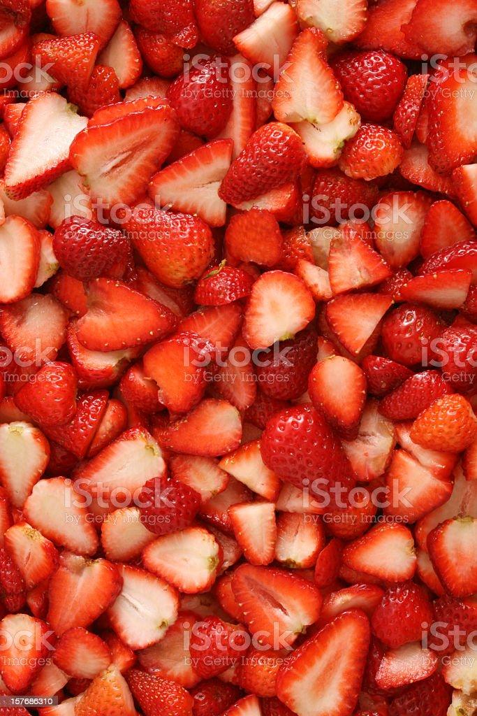 Sliced strawberries background stock photo